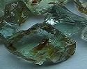 # Chrysoberyl faceted fine color change  rough from orissa gems